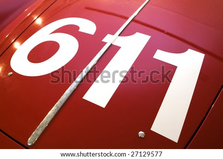 white number 611 of red old sport car - stock photo
