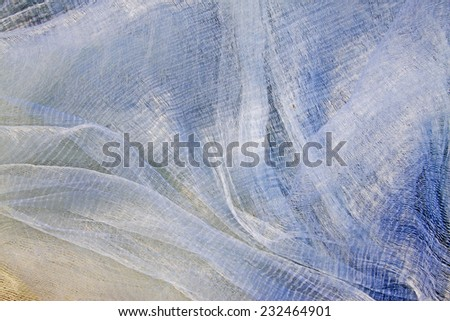 White nylon fishing nets, closeup of photo