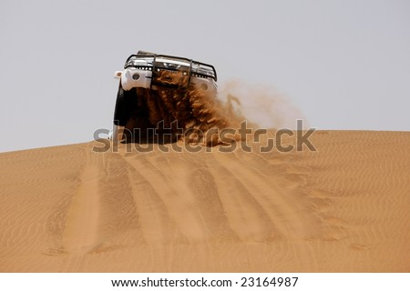 White off-road car fetching a dune, Africa