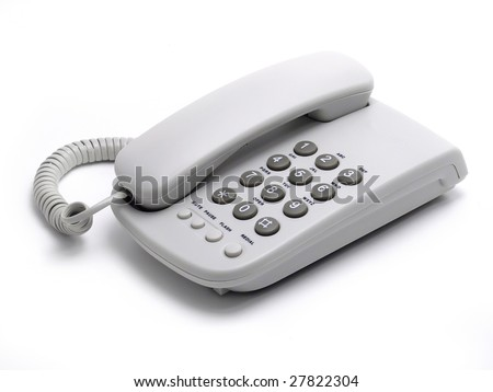 White office desk phone on white background