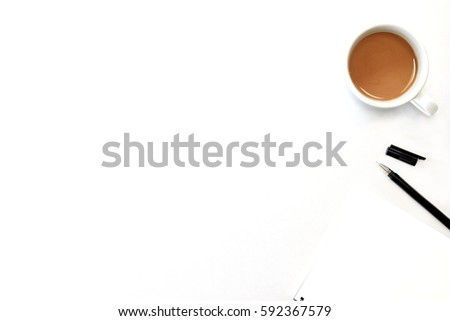 White office desk table with notebook, cup of coffee and supplies. Top view with copy space, flat lay.