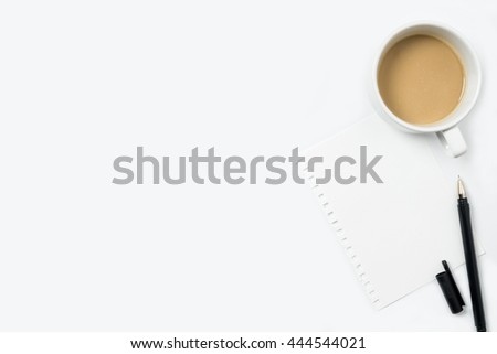 White office desk table with paper, coffee and pen. Top view with copy space, flat lay.