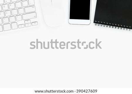 White office desk with computer keyboard, mouse, smartphone and notebook. Top view with copy space. - stock photo