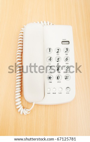 White office phone on the flat surface - stock photo