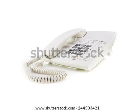 White office telephone on white background  - stock photo