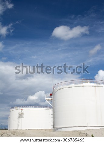 White oil reservoir. Oil and gas refinery plant. Industrial scene of oil field. Gas station