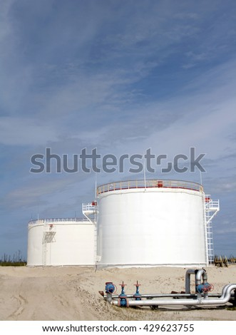 White oil reservoir. Oil and gas refinery plant. Industrial scene of oil field.Gas station - stock photo