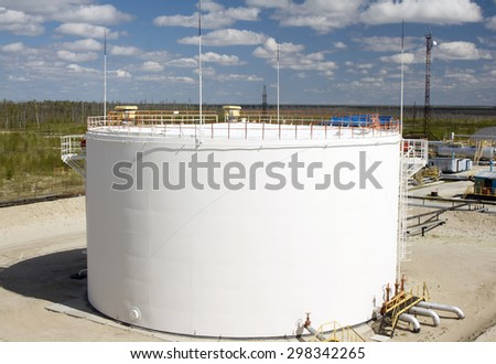 White oil reservoir. Oil and gas refinery plant. Industrial scene of oil field. Oil industry - stock photo