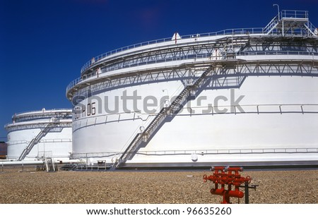 White oil reservoirs. - stock photo