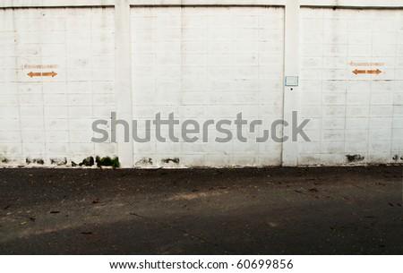 white old brick wall pavement - stock photo