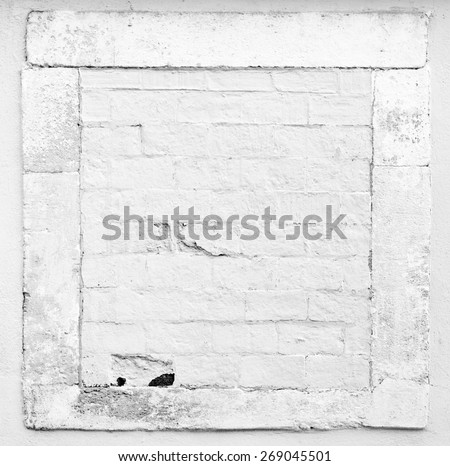 White old framed brick wall - stock photo