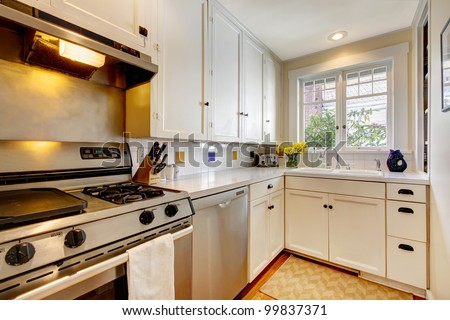 White old kitchen with stainless steal appliances. - stock photo