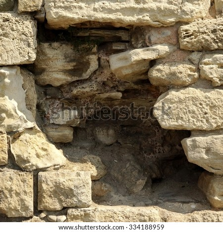 White Old Limestone Wall With Large Black Hole Frame Texture Background, Close Up - stock photo