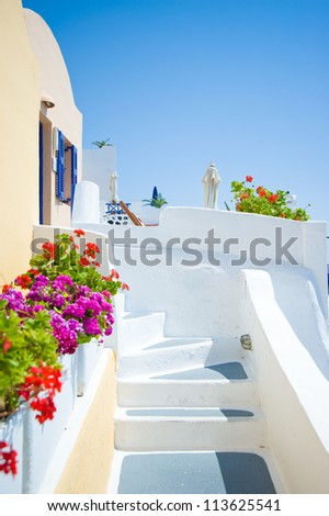 White old staircase and flowers at Santorini island,Greece
