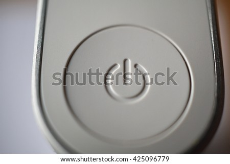 White ON and OFF circle button used to turn on and turn off the electric equipment in the modern design made of silver aluminum and white plastic  - stock photo