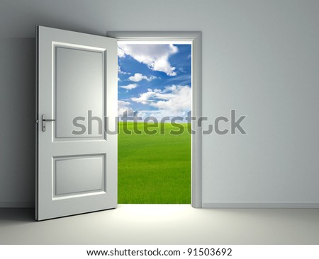 white open door inside empty room with view to green field and cloud sky background - stock photo