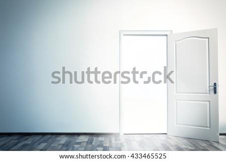 White open door with bright light - stock photo