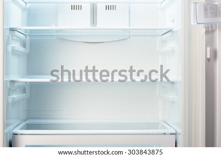 White open empty refrigerator. Weight loss diet concept. - stock photo