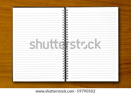 White open notebook on beech wood background. - stock photo