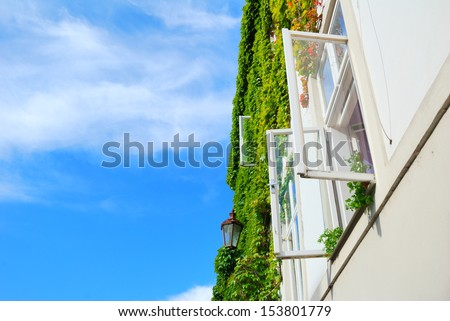 White open window with street lamp and blue sky - stock photo
