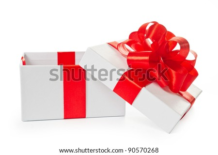 White opened pasteboard square gift box with red satin bow and ribbon isolated on white background with clipping path.