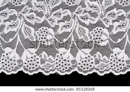 White openwork lace isolated on black background - stock photo