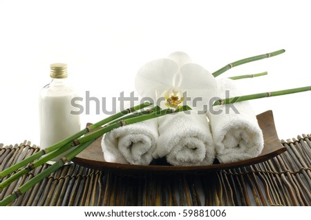 White orchid flower and spa item - stock photo