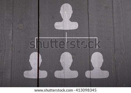 White organigram with white heads on dark black wooden background