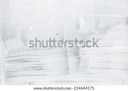 White paint layer on glass wall, background texture - stock photo