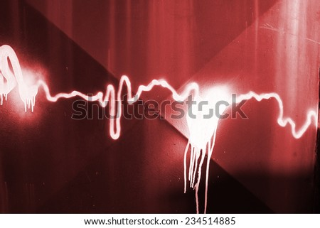 White paint sprayed on a red metal background  - stock photo