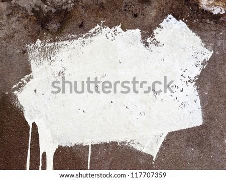 White paint strokes on grunge concrete wall - stock photo