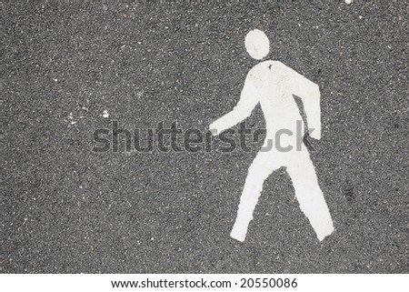 white painted man over black asphalt surface - stock photo