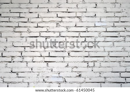 White painted old brick wall - stock photo