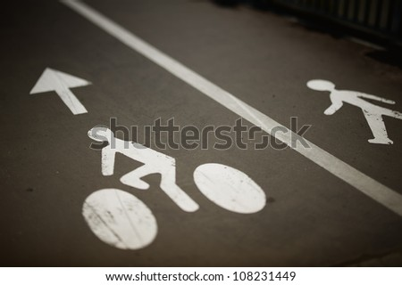 White painted sign for bikes and pedestrian lanes. - stock photo