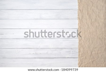 White painted wood board background in horizontal orientation with tan burlap panel on side.   Room or space for copy, text - stock photo
