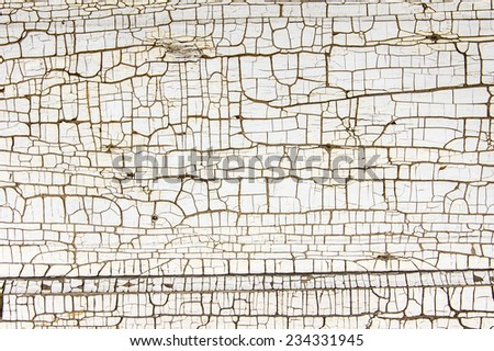 White painted wooden board showing crackled paint - stock photo