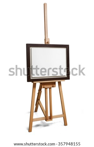 White painter canvas in frame on wooden easel isolated on white - stock photo