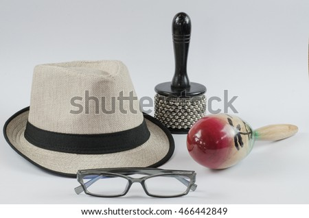 White panama hat and lens percussion  isolated on white background