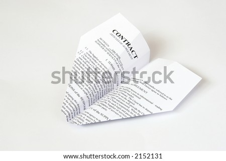 white paper airplane with contract text on it - stock photo