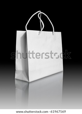 White paper bag on reflect floor and black background - stock photo