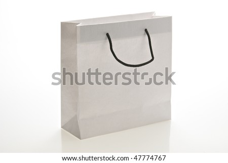 White paper bag with handle isolated on a white background. Clipping path included.