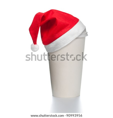White paper coffee cup with plastic cap on top. Blank space for copy on cup and besides. Red santa christmas hat on top of the cup. Square format. - stock photo