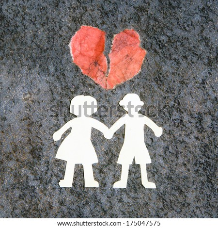 White paper couple silhouettes on the stone background with the