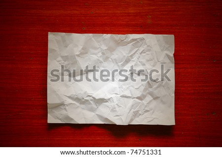White Paper Crumpled on wood texture background - stock photo