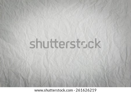 White paper crumpled with vignette border for background