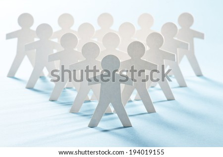 White paper cut-out figures arranged hierarchically - stock photo