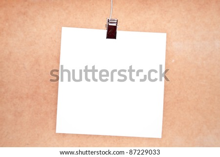 White paper for text writing against a board of wood