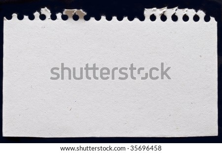 white paper from notebook isolated on black background - stock photo