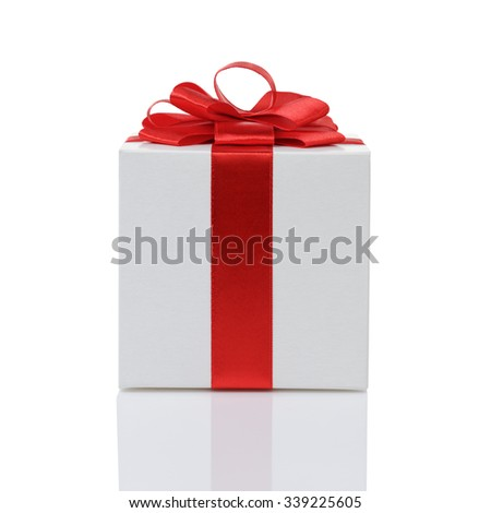 white paper gift box with red ribbon bow isolated on white - stock photo