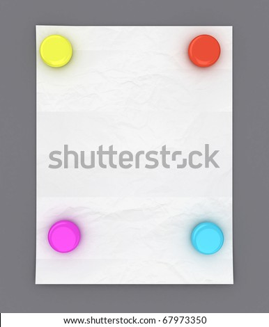 White paper hanging on gray wall with four color magnets
